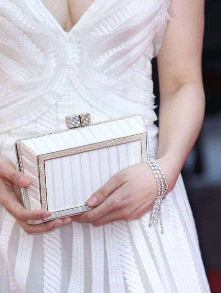Fan opted for complete elegance at the Cannes Film Festival. She paired her white gown with a matching box clutch.