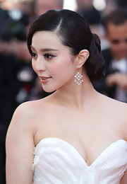 Fan Bingbing wore an elegantly wrapped chignon to the Cannes Film Festival. Dangling diamond earrigns completed her look.