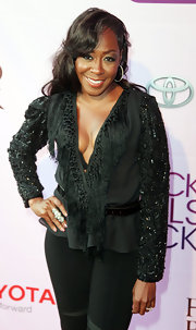 Tichina Arnold was an eye-catcher in a black blouse with beaded sleeves and a fringed neckline at the Black Girls Rock! 2011.
