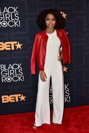 Yara Shahidi added a bit of color with a red leather jacket by Longchamp.