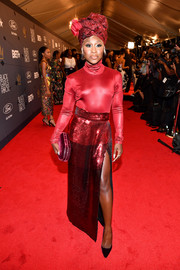 Cynthia Erivo hit the 2018 Black Girls Rock! event wearing a shiny red turtleneck by Sally LaPointe.