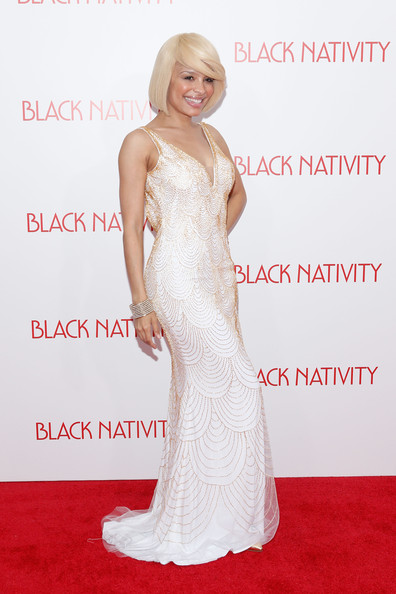 Antonique Smith went for sexy elegance at the 'Black Nativity' premiere in a white evening dress with a plunging neckline and scalloped detailing.