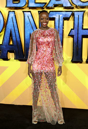 Florence Kasumba was a graphic explosion in this sheer, paillette-embellished gown by Jenny Packham at the European premiere of 'Black Panther.'