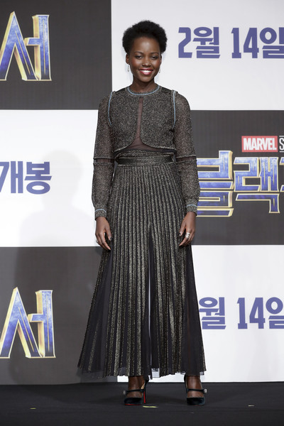 Lupita Nyong'o styled her look with a pair of black velvet Mary Janes by Christian Louboutin.
