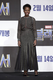 Lupita Nyong'o paired her top with a matching pleated maxi skirt.