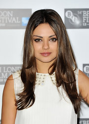 Mila Kunis opted for  simple center part hairdo while attending the photocall for 'Black Swan'.