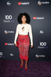 Tracee Ellis Ross tied her outfit together with a pair of strappy red pumps by Casadei.