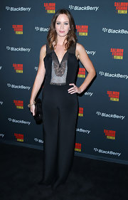 Emily was perfectly chic in a black silk jumpsuit with an intricately embellished bodice and sleeves.