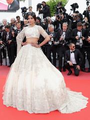 Sonam Kapoor completed her glamorous look with an embroidered white ball skirt.