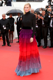 Cate Blanchett brought a rainbow of colors to the Cannes red carpet with this tiered turtleneck sweater dress by Givenchy Couture.