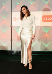 Kim Kardashian oozed sex appeal even without showing much skin in this tight white sweater during the #BlogHer16 Experts Among Us Conference.