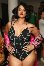 Dascha Polanco stood out at the Blonds fashion show wearing this black-and-white bodysuit.