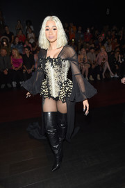 Cardi B looked quite the showgirl in an embellished bodysuit with a long train at the Blonds fashion show.