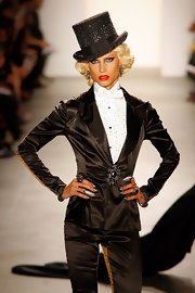 Phillipe Blond hit the runway wearing a satin tailored suit and bejeweled top hat.
