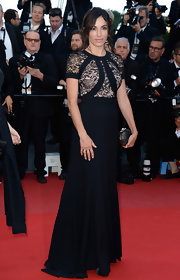 Aure Atika chose a sleek black dress with a nude illusion top for her look at the premiere of 'Blood Ties.'