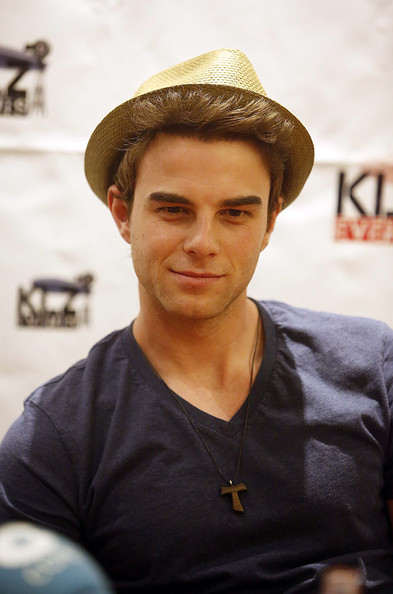 Nathaniel Buzolic chose a casual straw fedora to top off his look while out in Berlin.
