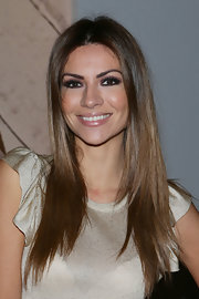 Alessia Ventura opted for a sleek look with a center part and straight hair at the Blugirl runway show in Milan.