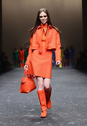 Coco Rocha rocked the Blumarine runway in an all-orange ensemble complete with bright orange knee-high boots.
