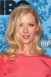 Gretchen Mol's shiny locks were set in subtle waves at the 'Boardwalk Empire' season premiere.  To try her look at home, create a deep, side part and curl three-inch sections of hair ends with a large-barreled curling iron.