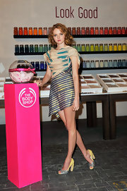 Lily Cole sported an eclectic ensemble at the launch of Beauty with Heart, consisting of glittery blue and yellow peep-toes and a modern striped dress.