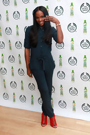 Tika Sumpter added pop to her look with red lace up peep-toe booties.