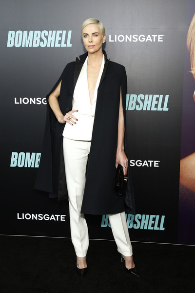 Charlize Theron looked sharp in a white vest and trousers combo at the New York screening of 'Bombshell.'