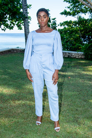 Lashana Lynch was casual-chic in a baby-blue Emilia Wickstead blouse with blouson sleeves at the 'Bond 25' film launch.