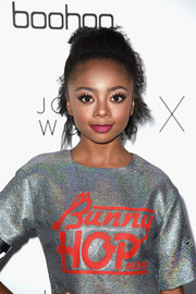 Skai Jackson pulled her curls back into a messy ponytail for the Boohoo x Jordyn Woods fashion event.
