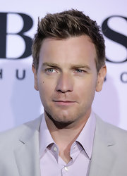 Ewan McGregor showed off his spiked haircut while hitting the Hugo Boss fashion show.