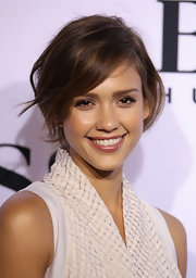 Jessica Alba flashed her pearly whites as she showed off her loose bun at the Boss Black show.
