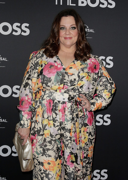 Melissa McCarthy paired a gold Marie Turnor leather clutch with a floral jumpsuit for the Sydney premiere of 'The Boss.'