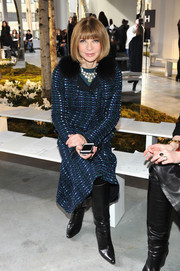 Anna Wintour was classy, as always, in a blue tweed coat with a black fur collar during the Boss Women fashion show.