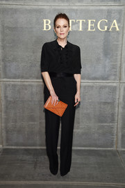 Julianne Moore injected a bright pop with an orange envelope clutch.