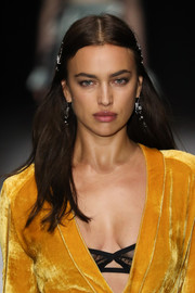 Irina Shayk sported a simple center-parted hairstyle while walking the Bottega Veneta runway.
