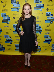 Ashley Bell opted for a little black dress with long sleeves and lace for her red carpet look at SXSW.