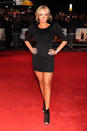 "Aisleyne attended the UK premiere of the ""Bounty Hunter"" looking glamourous in her on-trend power shoulder dress. She completed her look with studded ankle boots and face framing curls."