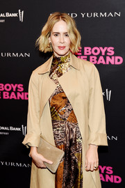 Sarah Paulson arrived for the 'Boys in the Band' 50th anniversary celebration carrying a simple nude suede clutch.