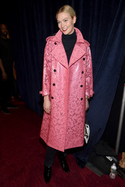 Karlie Kloss looked cute in this laminated pink lace trenchcoat by Burberry at the Brandon Maxwell fashion show.