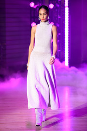 Joan Smalls looked simply stylish in a sleeveless gray turtleneck dress while walking the Brandon Maxwell runway.