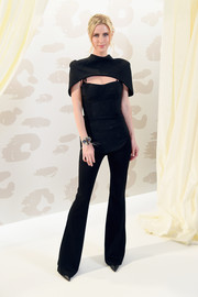 Nicky Hilton Rothschild looked sultry in a black corset top with a matching capelet at the Brandon Maxwell fashion show.