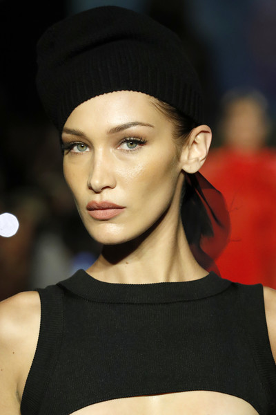 Bella Hadid accessorized with a black knit beanie at the Brandon Maxwell runway show.