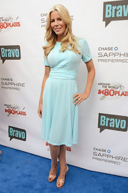 Aviva Drescher matched her light blue dress with a pair of nude strappy sandals at the Around the World in 80 Plates event.
