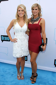 Alexis Bellino teamed her red bodycon dress with black T-strap heels with thick ankle cuffs.