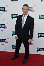 Andy Cohen chose a black two-button suit to pair with a crisp white button down and a striped tie for his look at the Bravo Media Event in Hollywood.