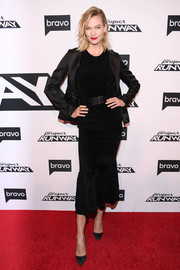 Karlie Kloss polished off her look with a black satin blazer, also by Brandon Maxwell.