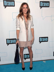 SJP showed off the nude trend while walking the carpet at a Bravo event. Her purple suede tote bag kind of threw the whole look off, however.
