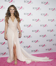 Elizabeth Hurley looked like a goddess in her floaty nude Donna Karan gown during the Pink Carpet Party.