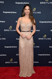 Olivia Munn glittered in a beaded gold gown by Laura Basci at the Breitling #LEGENDARYFUTURE Roadshow.