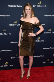 Kate Upton went for some elegant shine in an asymmetrical bronze off-the-shoulder dress by Haney at the Breitling #LEGENDARYFUTURE Roadshow.