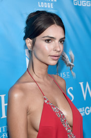Emily Ratajkowski made an appearance at a UN event wearing a messy-sexy updo.